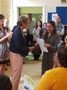 Learner receiving certificate at MAES celebration event 2019