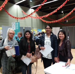 Manchester Adult Education learners networking at a jobs fair.